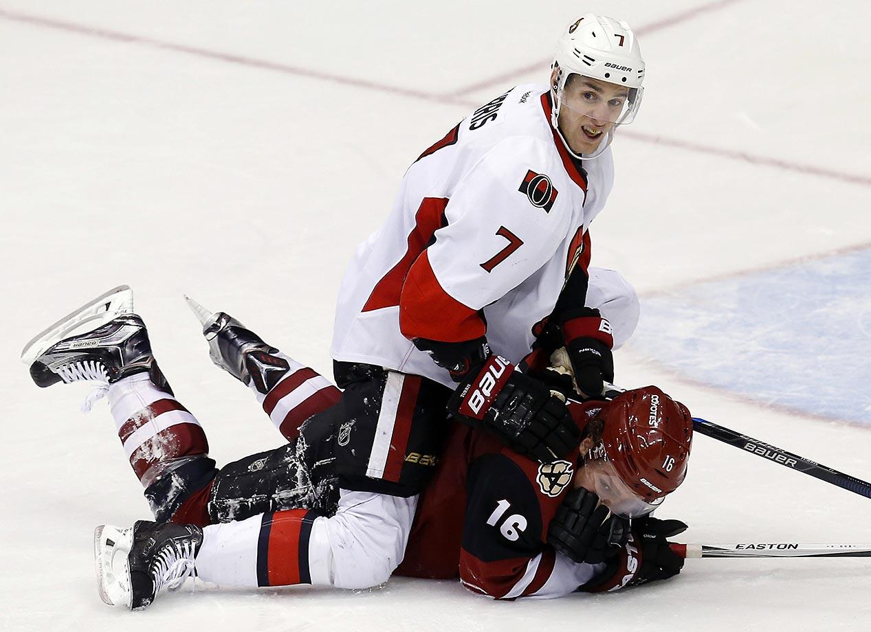 Kyle Turris of the Ottawa Senators shows a new defensive technique against Max Domi of the Arizona Coyotes.