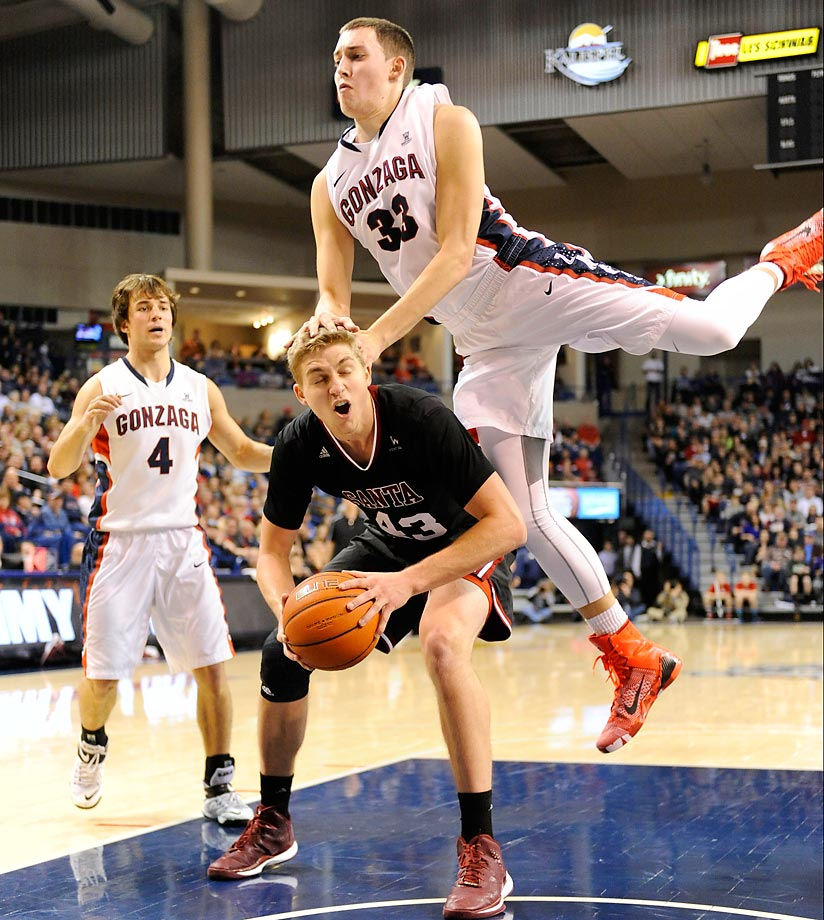 Gonzaga forward Kyle Wiltjer fouls Santa Clara forward Nate Kratch after falling for a pump fake.