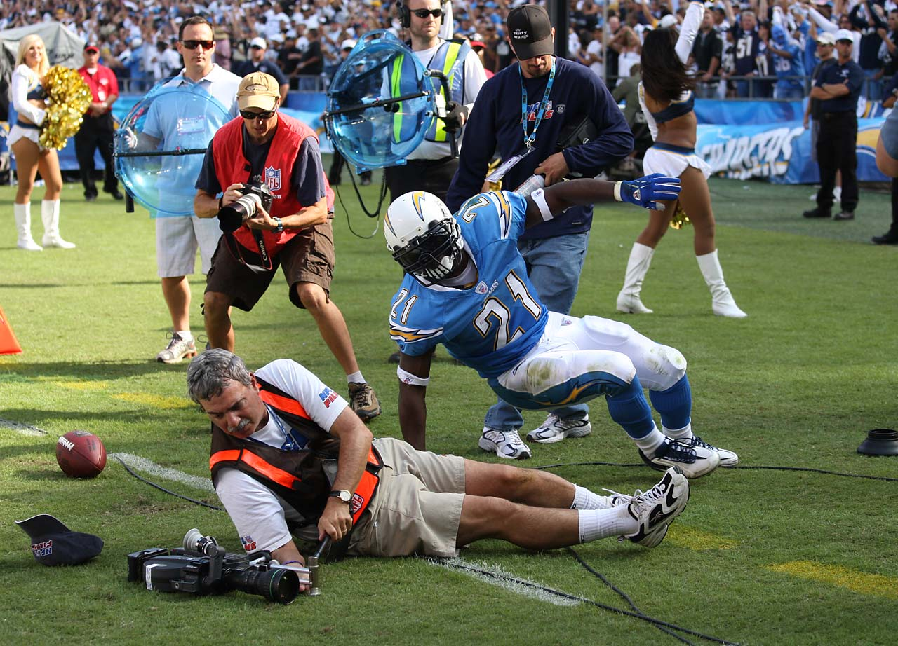 LaDainian Tomlinson got taken down by an NFL Films cameraman while getting ready to take on the Oakland Raiders in San Diego in October 2007.