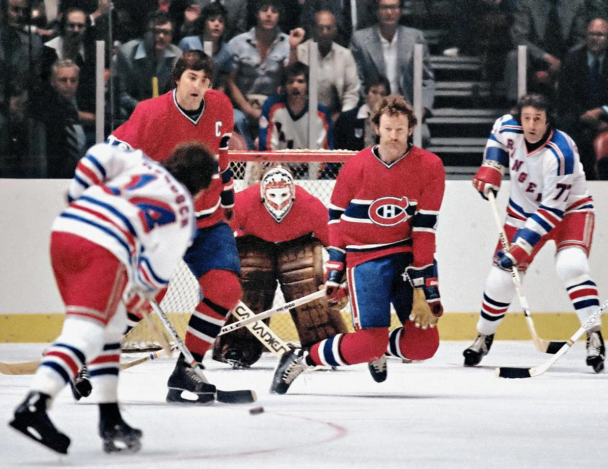 "The 6'-4"" Robinson was the ace of a Montreal defense corps that anchored four straight Stanley Cup teams (1976-79). He combined the offensive skills of backline partner Guy Lapointe and the defensive stinginess of Serge Savard, and his long reach made him tough to elude. He finished his career with the highest plus-minus rating (+730) in NHL history and later won his seventh Cup as coach of the Devils in 2000."