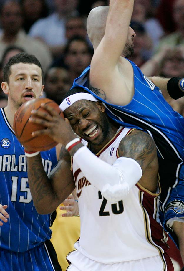 LeBron James gets fouled by Orlando Magic's Marcin Gortat during Game 5 of the Eastern Conference finals on May 28, 2009, in Cleveland.