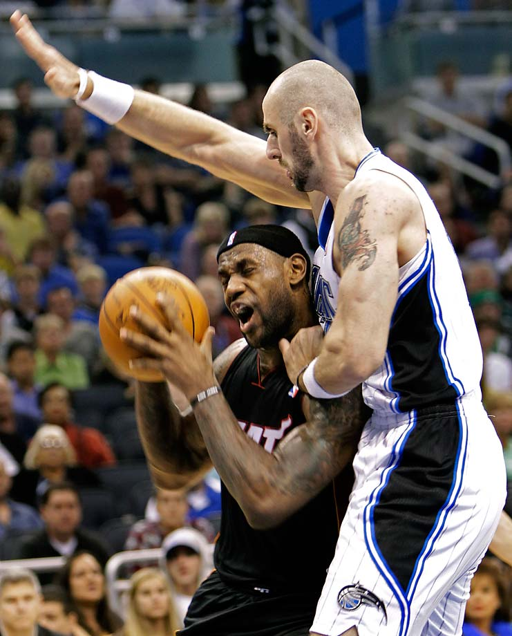 LeBron James is fouled by Orlando Magic's Marcin Gortat during a Nov. 24, 2010, game in Orlando.