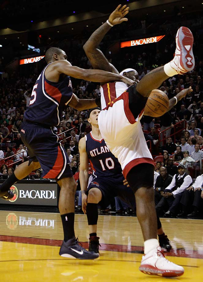 LeBron James is fouled by Atlanta Hawks center Al Horford during a Dec. 4, 2010, game in Miami.