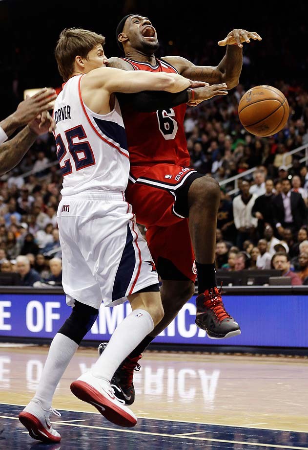 LeBron James is fouled by Atlanta Hawks forward Kyle Korver during a iFeb. 20, 2013, game in Atlanta.