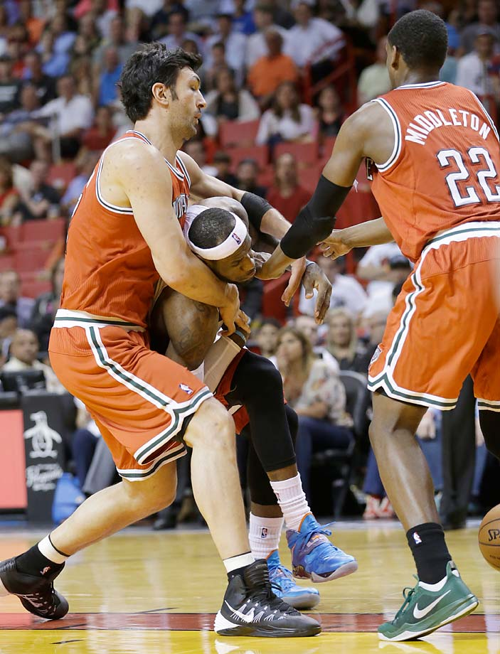 LeBron James is fouled by Milwaukee Bucks center Zaza Pachulia during an April 2, 2014, game in Miami.
