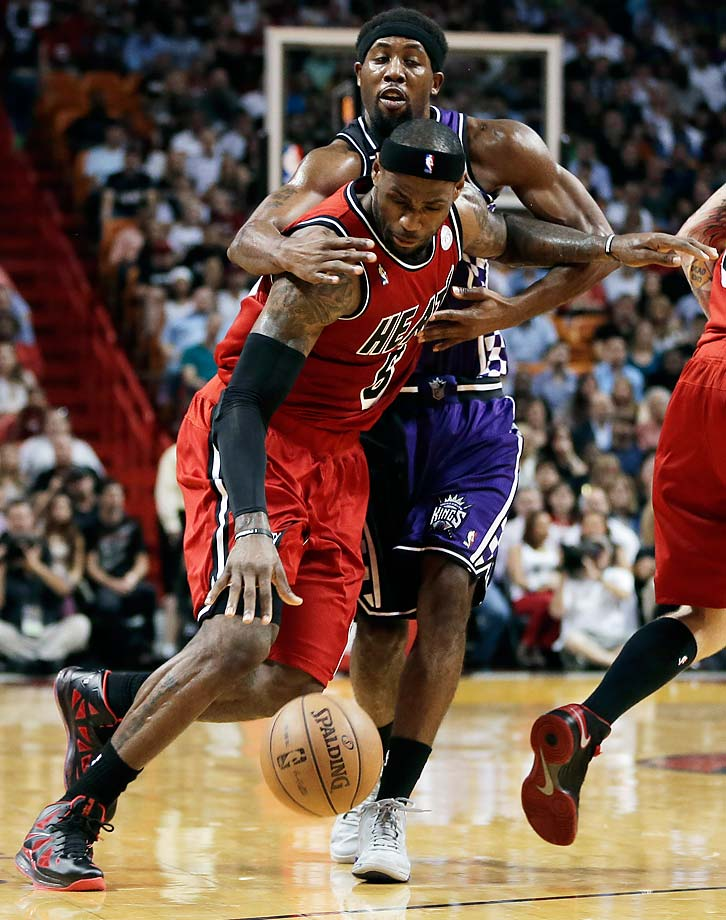 Sacramento Kings' John Salmons fouls LeBron James during a Feb. 26, 2013, game in Miami.