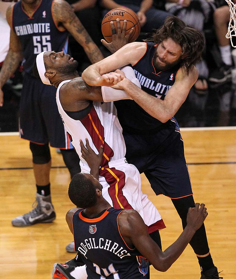 LeBron James is fouled by the Charlotte Bobcats' Josh McRoberts during Game 2 of an Eastern Conference quarterfinal in Miami on April 23, 2014.
