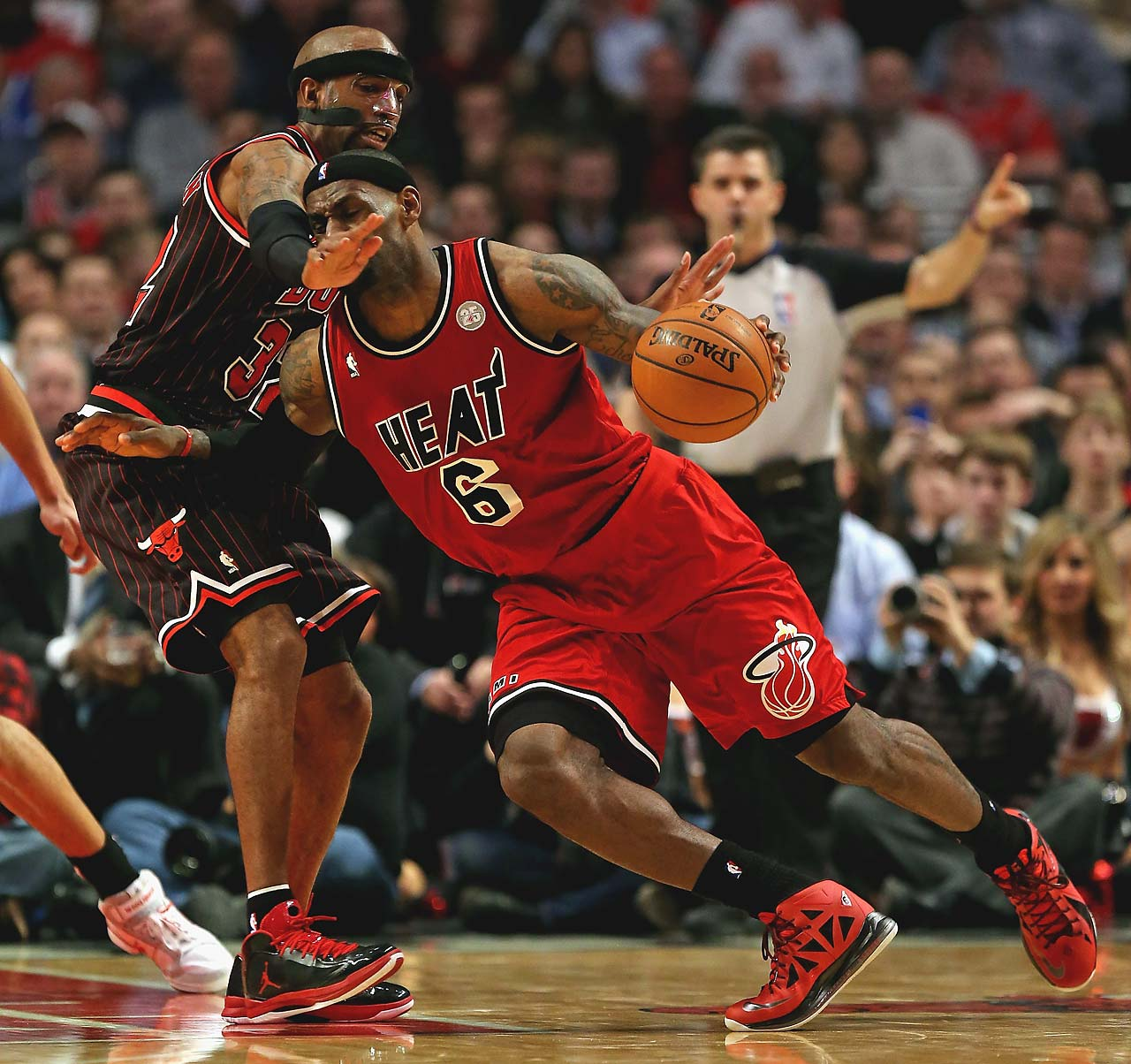 LeBron James is fouled by Richard Hamilton of the Chicago Bulls at the United Center on February 21, 2013 in Chicago.