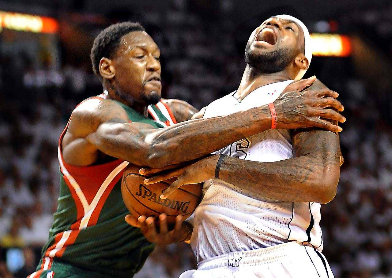 LeBron James is fouled by the Milwaukee Bucks' Larry Sanders in Game 2 of the opening round of the 2013 playoffs in Miami on April 23, 2013.