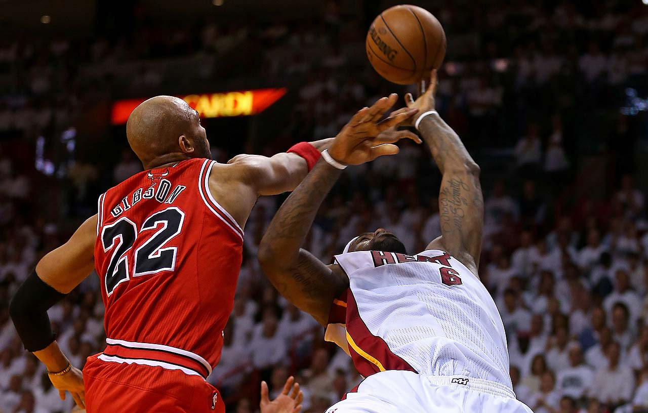 LeBron James is fouled by Taj Gibson #22 of the Chicago Bulls during Game 5 of the 2013 Eastern Conference Semifinals on May 15 in Miami.