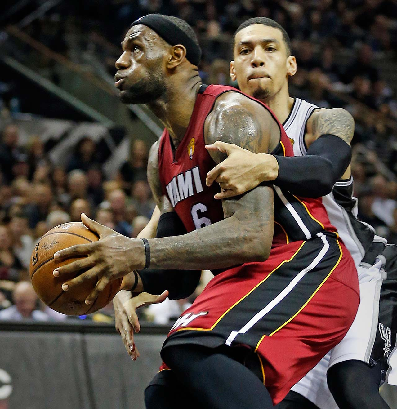 LeBron James is fouled by the San Antonio Spurs' Danny Green in Game 1 of the 2014 Finals on June 5 in San Antonio.