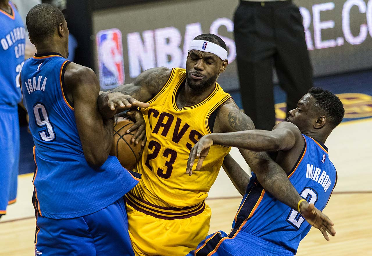 LeBron James is fouled hard by Oklahoma City Thunder Serge Ibaka and Anthony Morrow  during a Jan. 25, 2015, game in Cleveland.