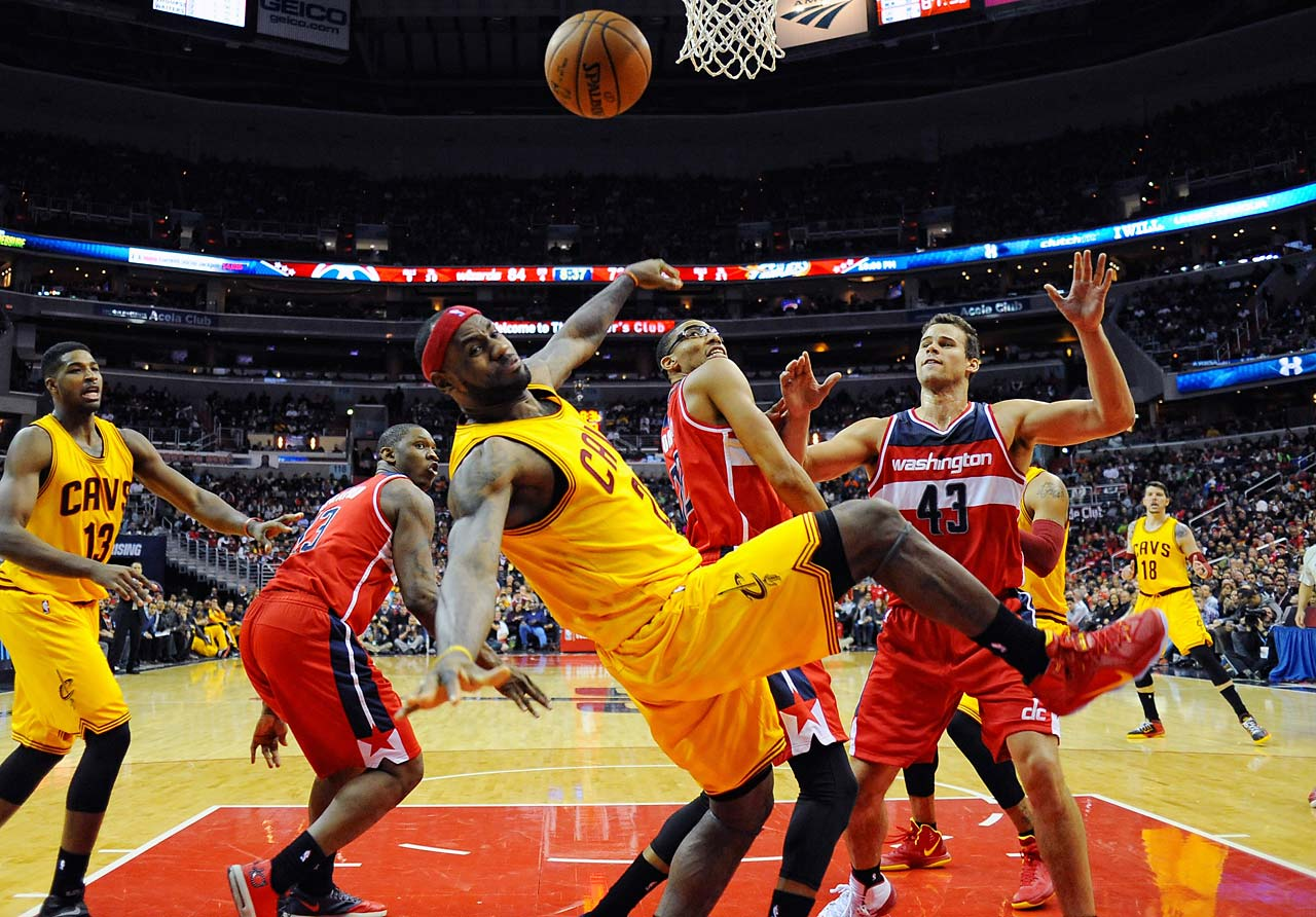 LeBron James goes to the floor after a foul by Washington Wizards forward Otto Porter Jr. during a Nov. 21, 2014, game in Washington, D.C.