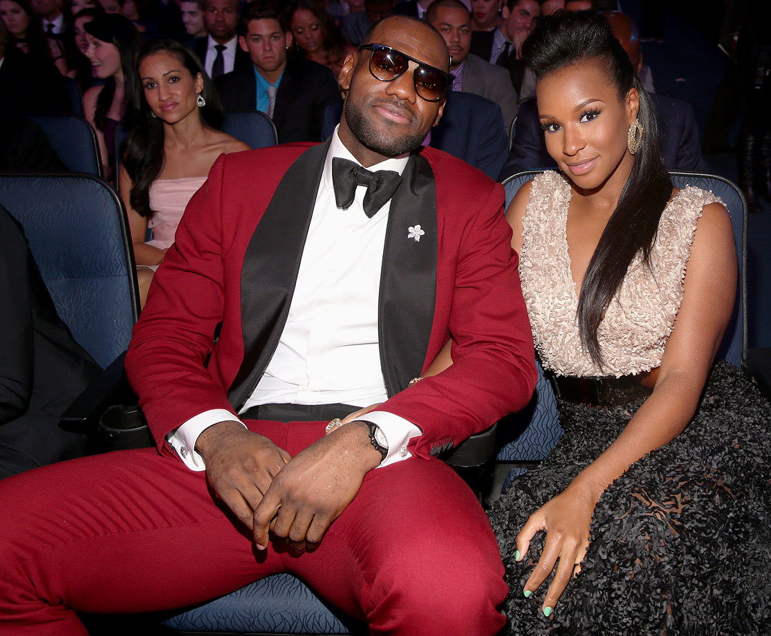 Don't try this at home, folks. You have to be as cool as LeBron to pull off a burgundy suit and sunglasses inside.