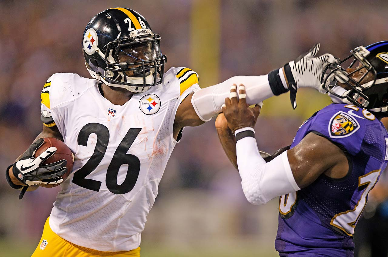 LeVeon Bell shoves a Raven out of his way on a night when he ran for 59 yards and caught five passes for 48 yards.