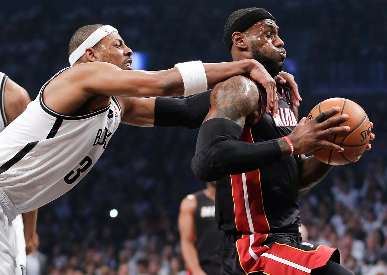 Brooklyn Nets forward Paul Pierce fouls LeBron James (6) during Game 3 of an Eastern Conference semifinal on May 10, 2014, in New York.