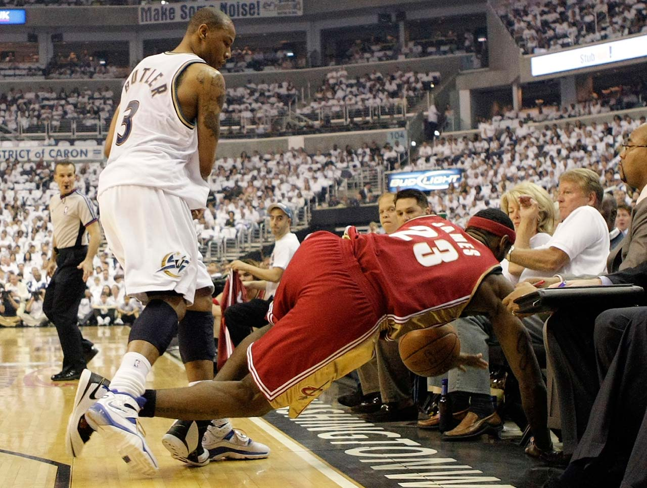 LeBron James is pushed out-of-bounds by Washington Wizards' Caron Butler during a first-round playoff game on May 2, 2008, in Washington.