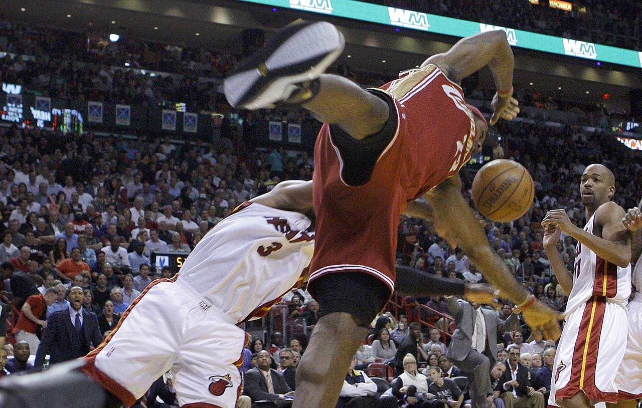 LeBron James is fouled by Miami Heat guard Dwyane Wade during a Jan. 25, 2010, game in Miami.