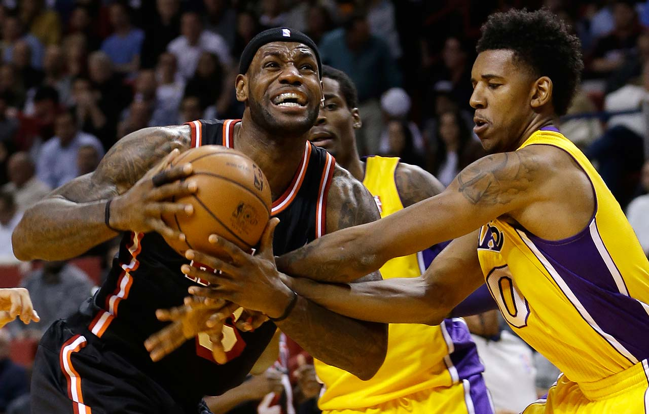 Los Angeles Lakers Nick Young fouls LeBron James during a Jan. 23, 2014, game in Miami.