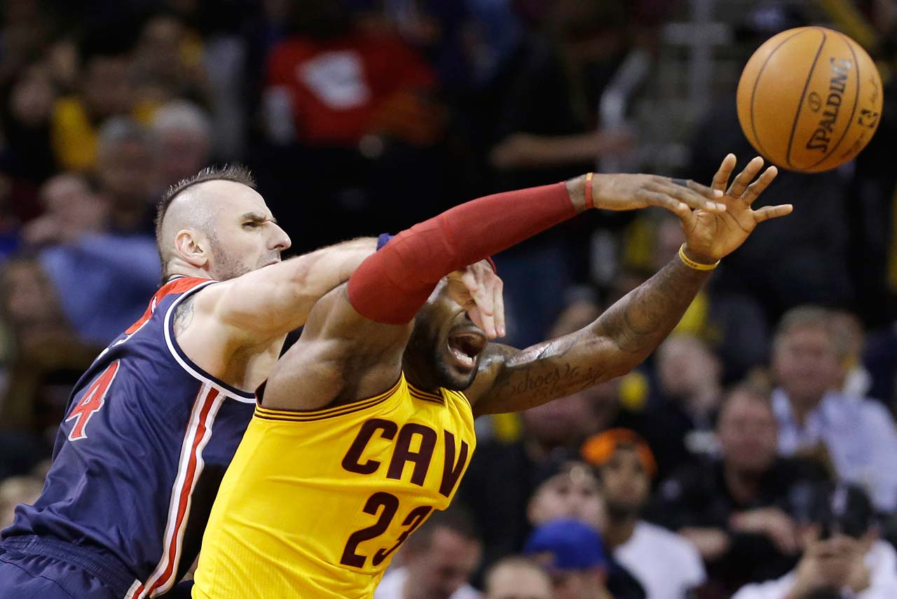 Washington Wizards' Marcin Gortat fouls LeBron James (23) during a Nov. 26, 2014, game in Cleveland.
