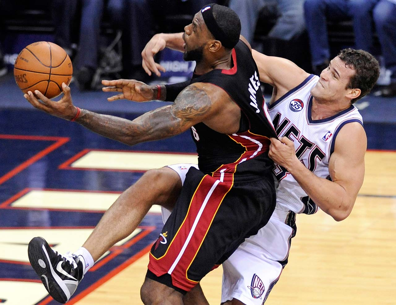 LeBron James is fouled by New Jersey Nets forward Kris Humphries during a Jan. 7, 2012, game in Newark, N.J.