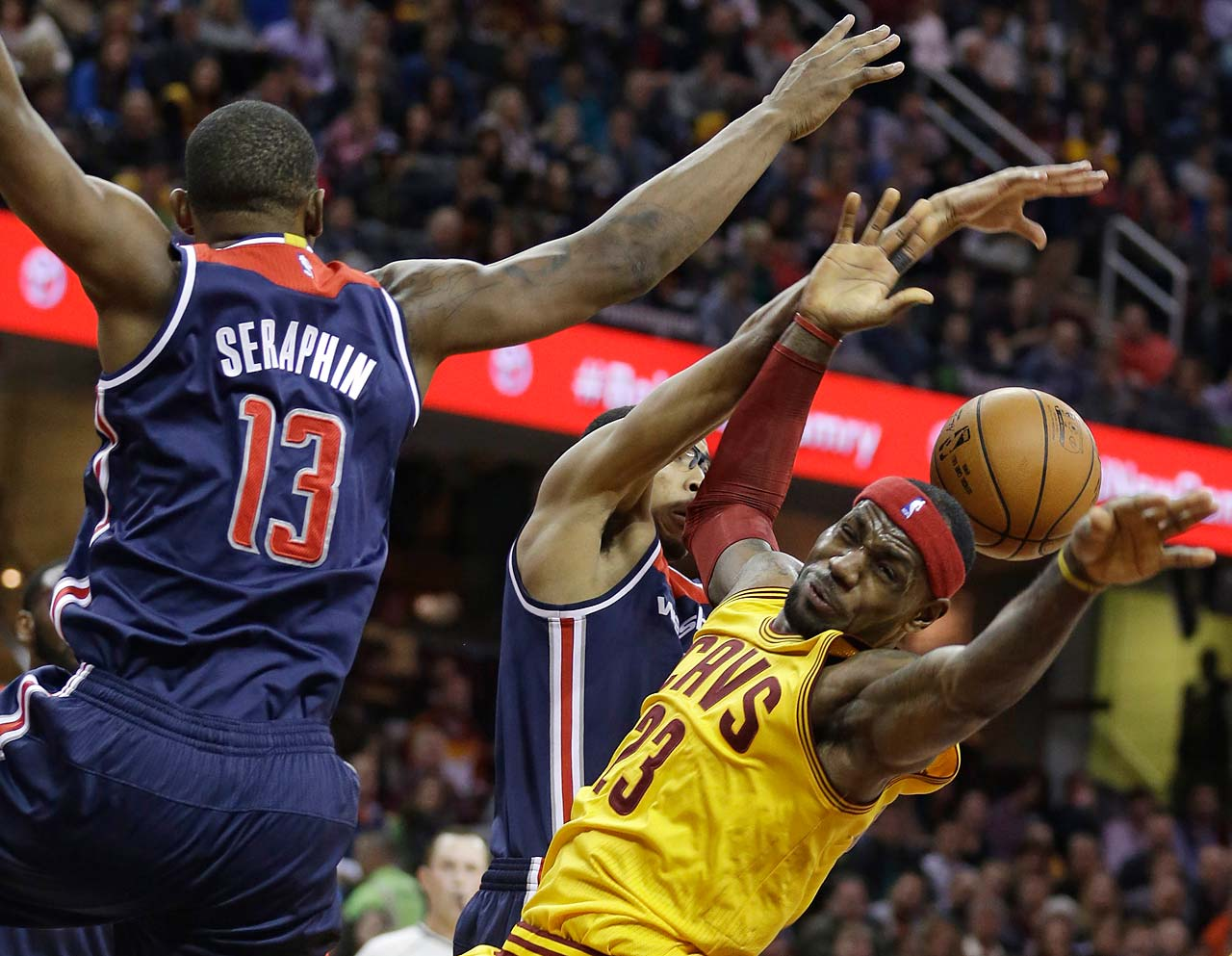 LeBron James is fouled by Kevin Seraphin of the Washington Wizards during a Nov. 26, 2014, game in Cleveland.