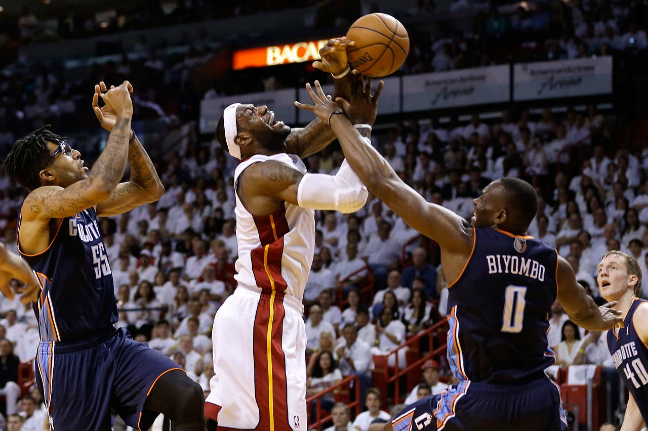 LeBron James is fouled by Charlotte Bobcats' Bismack Biyombo during Game 1 of an opening-round playoff series on April 20, 2014, in Miami.