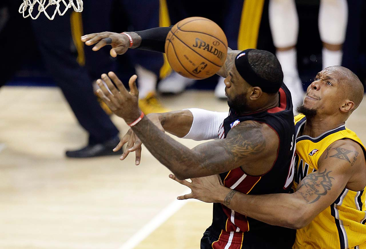Indiana Pacers forward David West fouls LeBron James during Game 2 of the Eastern Conference finals in Indianapolis on May 20, 2014.