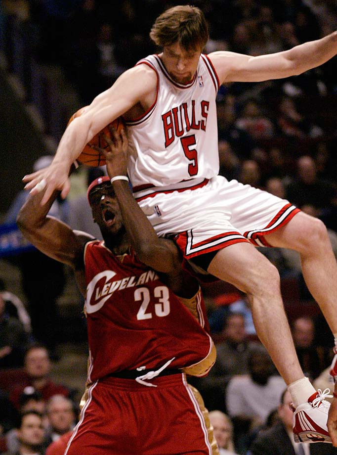 Chicago Bulls' Andres Nocioni fouls LeBron James as he goes up for a shot during a Dec. 8, 2004, game in Chicago.