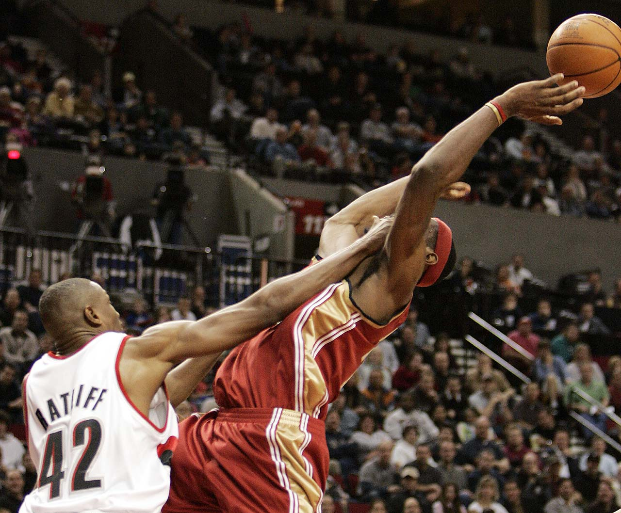 LeBron James is fouled going to the hoop by rail Blazers center Theo Ratliff during a Jan. 15, 2006, game in Portland.