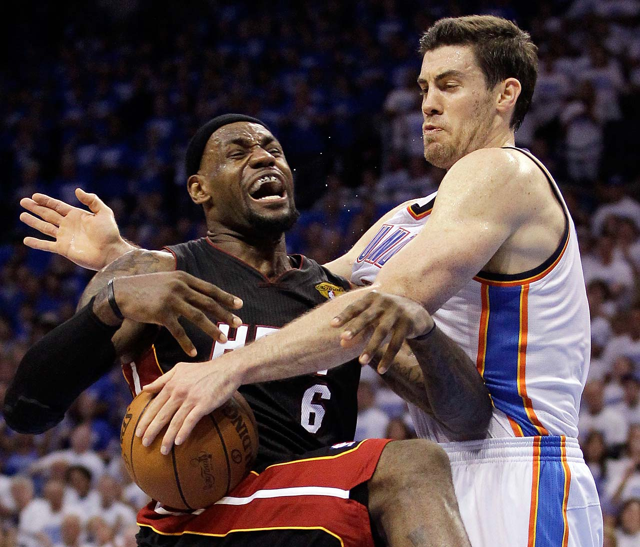 Oklahoma City Thunder power forward Nick Collison fouls LeBron James during Game 2 of the NBA finals on June 14, 2012.