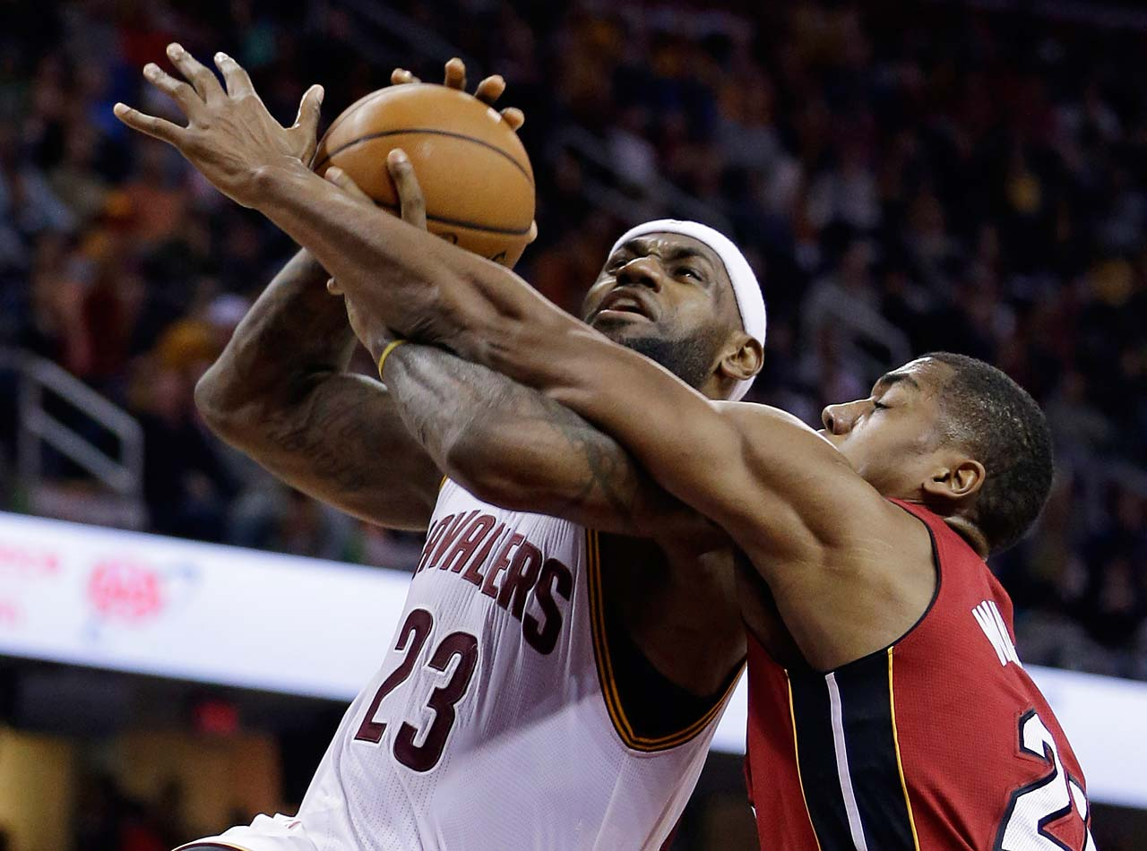LeBron James  is fouled by Miami Heat's Hassan Whiteside during a game on Feb. 11, 2015, in Cleveland.