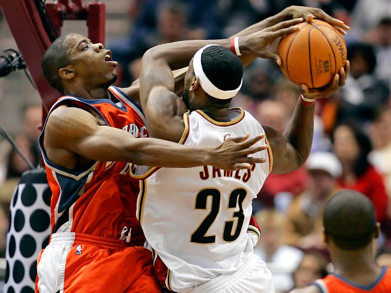 Charlotte Bobcats Bernard Robinson fouls LeBron James during a March 22, 2006, game in Cleveland.