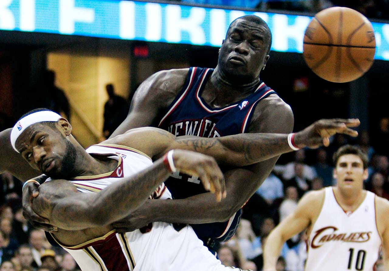 New Jersey Nets' DeSagana Diop fouls LeBron James during an April 9, 2008, game in Cleveland.