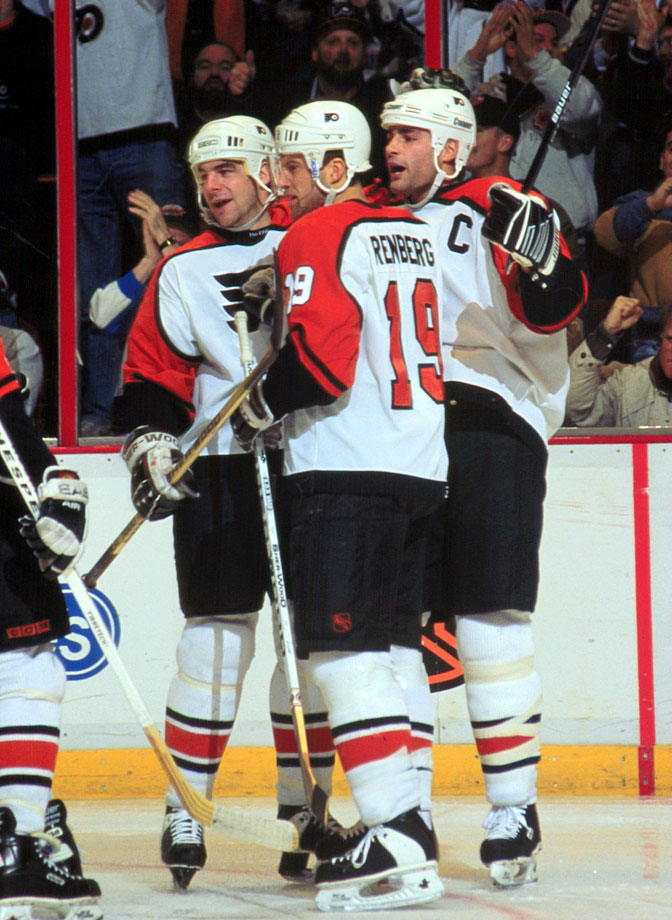 "One of the league's most potent and feared lines from 1995 to 1997, center Lindros, left winger LeClair and right winger Renberg were a physically dominant trio that demanded a nickname. Bob's Big Boys (referring to GM Bobby Clarke), the Doom, Gloom and Zoom Line, the JEM Line and The Crazy Apes were considered until Flyer forward Jim Montgomery was moved to remark that they looked like ""the Legion of Doom out there."""