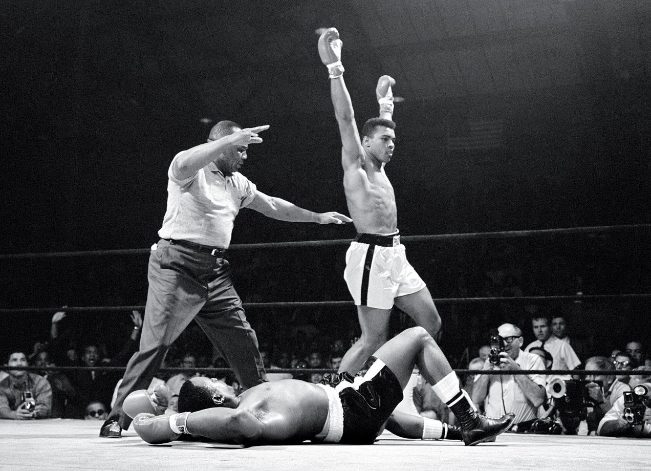 Muhammad Ali celebrates his knockout win in Lewinston, Maine.