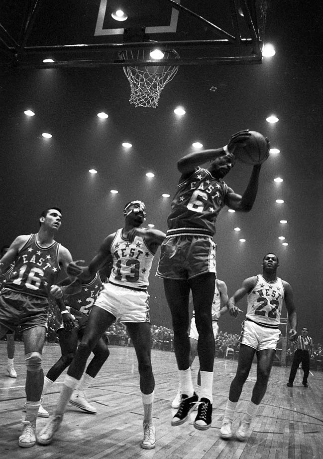 Bill Russell rebounds in front of Wilt Chamberlain during the 15th NBA All-Star game, held at Kiel Auditorium in St. Louis.