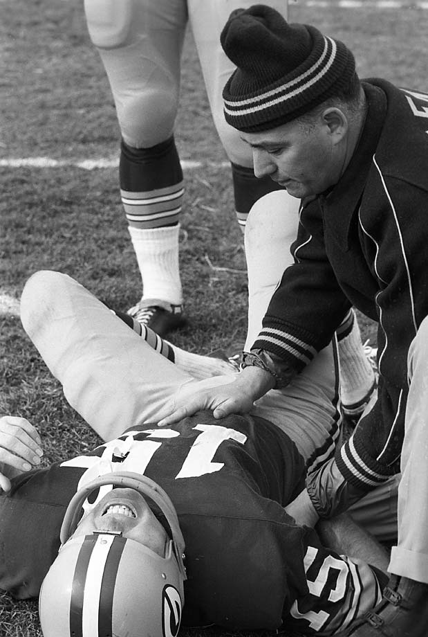 Green Bay Packers quarterback Bart Starr in pain after sustaining an injury on the first play against the Baltimore Colts at Lambeau Field.