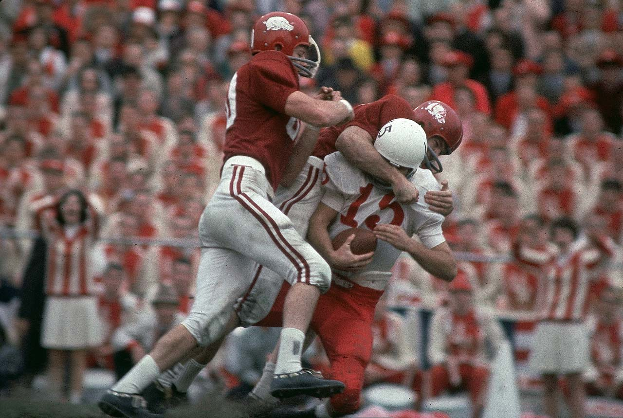 Nebraska quarterback Bob Churchich is sacked by Arkansas defenders at Cotton Bowl Stadium. The Razorbacks won 10-7 to nail down their first national title.