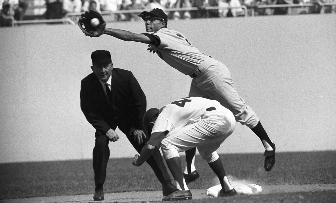 Minnesota's Zoilo Versalles catches a wild throw during a pickoff attempt of Dick Tracewski during Game 5 of the World Series.