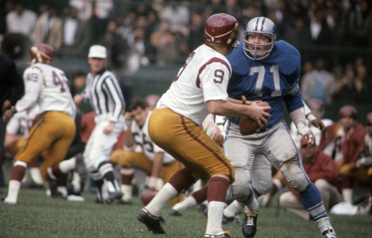 Alex Karras of the Detroit Lions pressures Washington quarterback Sonny Jurgensen at Tiger Stadium.