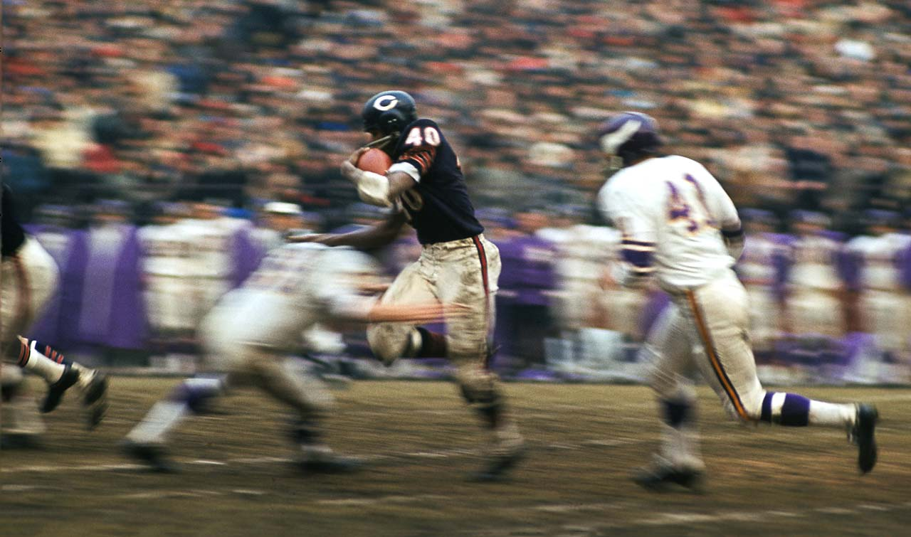 Gale Sayers rushes past the Minnesota Vikings' defense at Wrigley Field.