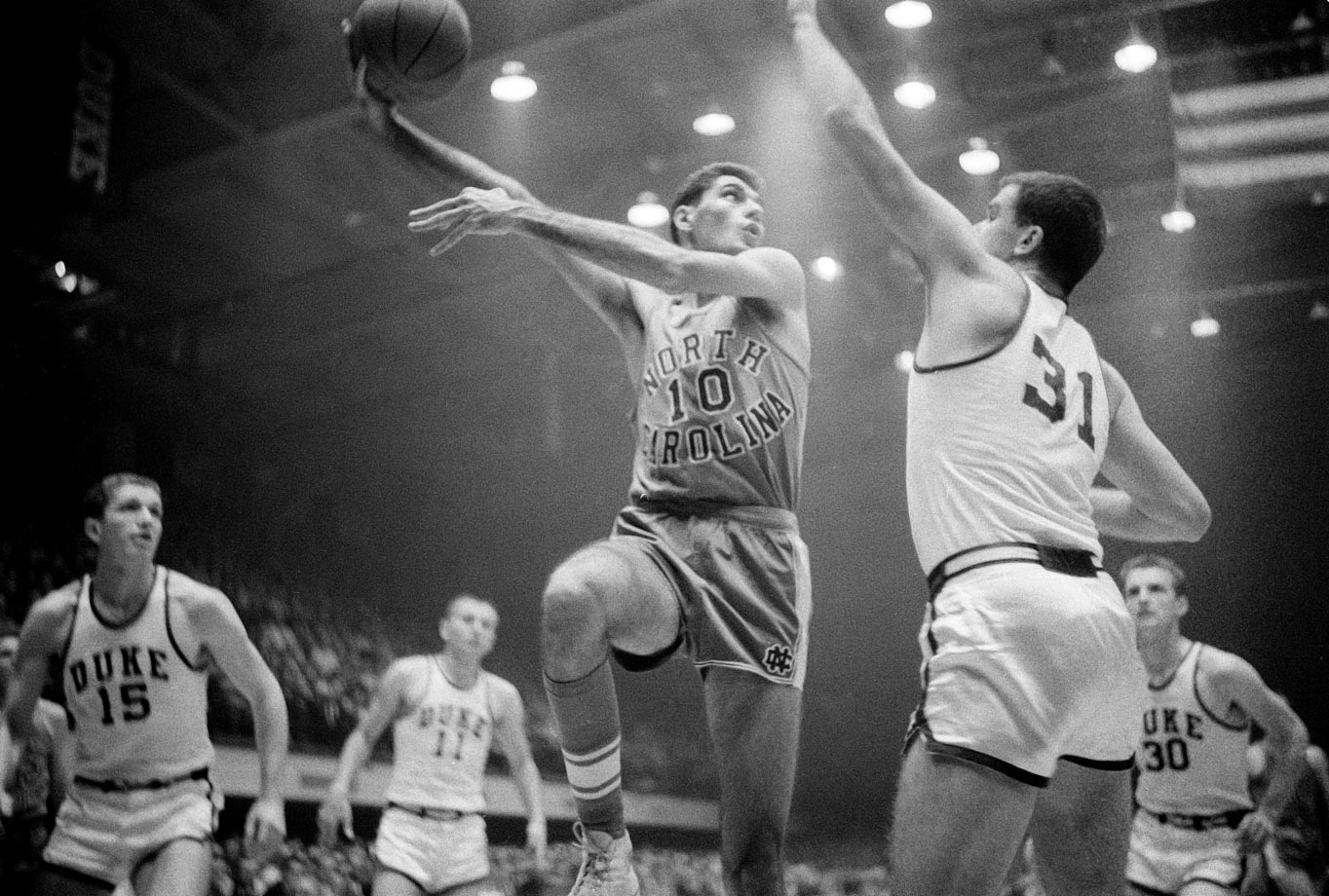 In 1957, Rosenbluth had one of the best seasons in history. He is one of just two players to win national Player of the Year, ACC Player of the Year, ACC tournament MVP and NCAA regional MVP in the same season. That year Rosenbluth averaged 28.0 points -- the highest season scoring average in North Carolina history -- and 8.75 rebounds, and the Tar Heels claimed a national championship in an epic battle with Kansas. In the championship game, Rosenbluth scored 20 points to lead the Jayhawks to a triple-overtime victory over Wilt Chamberlain-led Kansas.