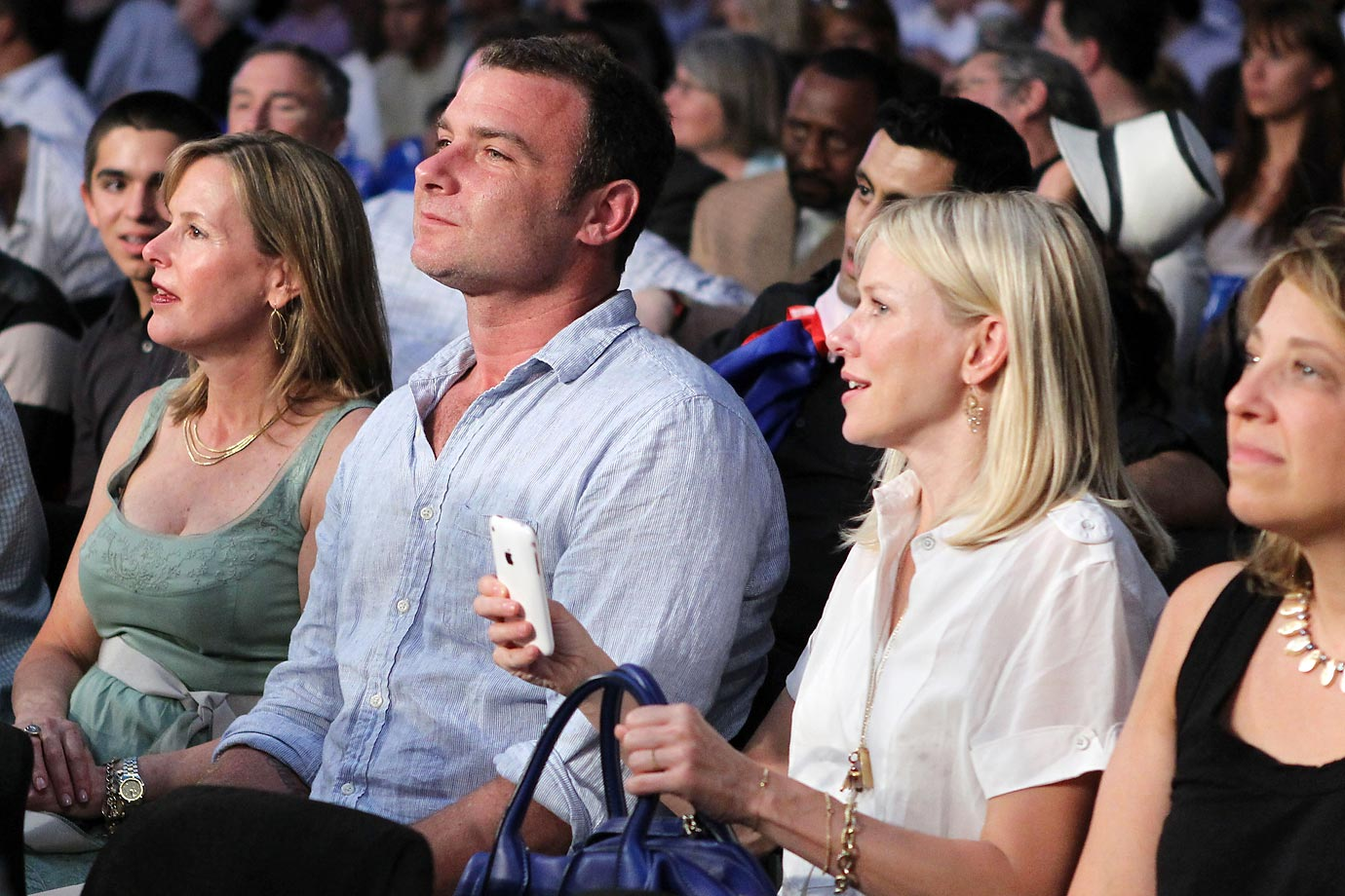 Liev Schreiber and actress Naomi Watts watch the bout between James Moore and Pawel Wolak.