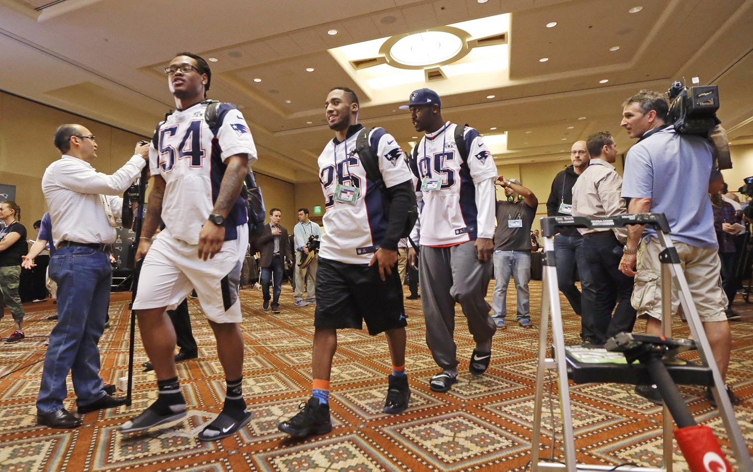 Dont'a Hightower (54), cornerback Logan Ryan (26), and defensive end Chandler Jones (95) leave at the end of the team's media availability.