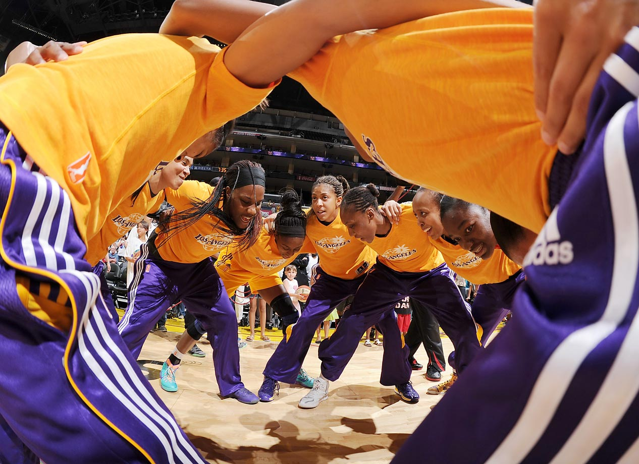The Los Angeles Sparks in their pregame huddle just before tip-off of a game against the Phoenix Mercury at the Staples Center. The Mercury went on to win in a blowout, 93-73.