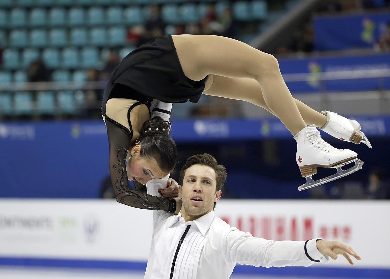 Lubov Iliushechkina and Dylan Moscovitch of Canada perform what looks painful at the ISU Four Continents Figure Skating Championships in Seoul, South Korea.