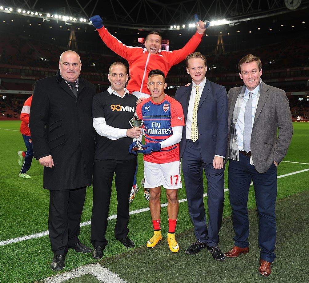 Lukas Podolski photobombs Alexis Sanchez.