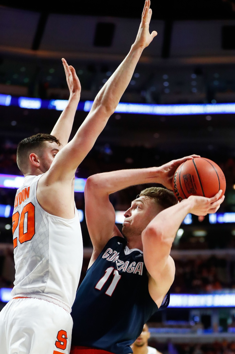 With 22 seconds to go, Michael Gbinije followed his own miss with a layup to put Syracuse up by one over Gonzaga. Later, with four seconds to go, Zags guard Josh Perkins drove and put up a floater to win, but it was rejected by Syracuse forward Tyler Lydon, who already had five blocks that day. Syracuse won 63–60 and moved on to the Elite Eight despite giving up a combined 42 points to Gonzaga's Kyle Wiltjer and Domantas Sabonis.