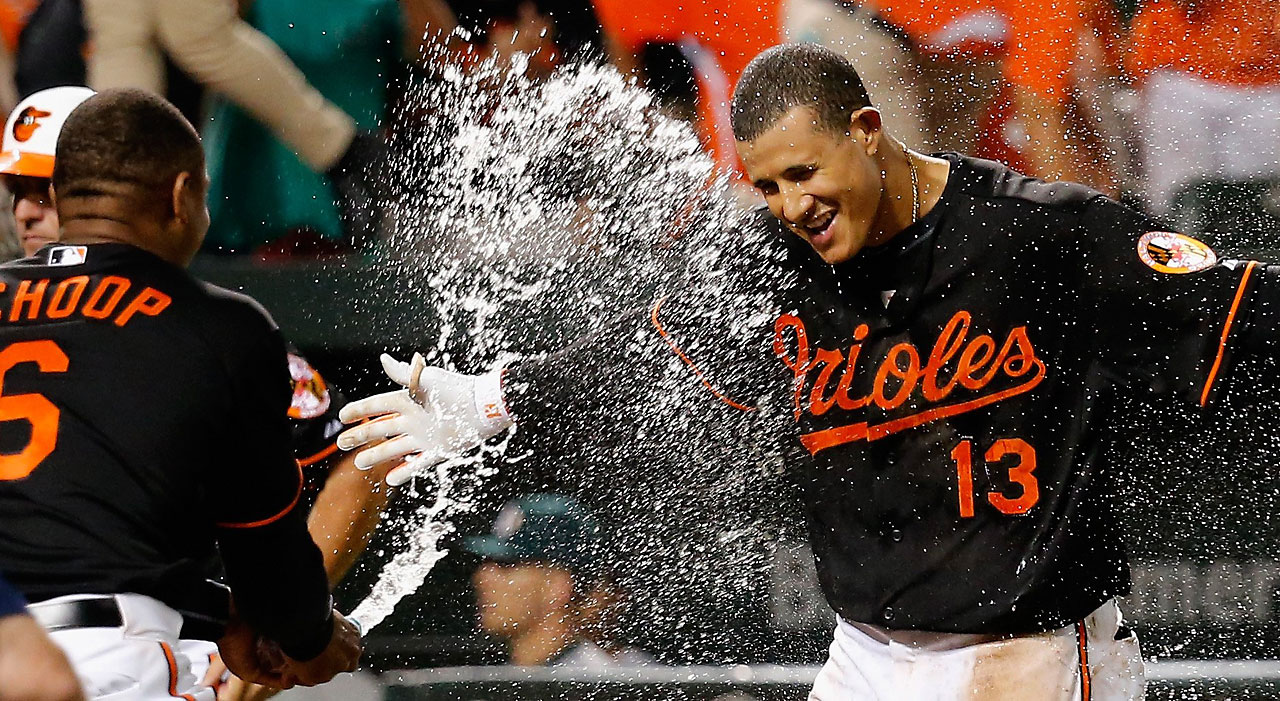 Manny Machado is sprayed with water by teammate Jonathan Schoop after hitting a walk off home run.